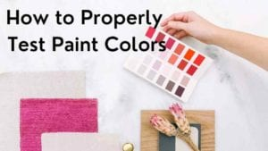 Paint samples on a marble counter with flowers and the title: how to properly test paint colors