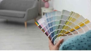 Person holding up color swatch displaying multiple color options