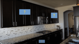 Image of black kitchen cabinets w/question marks on doors and drawers