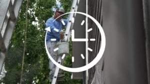 image of painter painting an exterior with a graphic of a clock overlayed