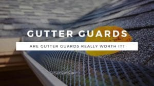 close up image of gutter guards with title graphic that reads: Gutter Guards: Are gutter guards really worth it?