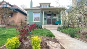 a mint green exterior of a denver home painted by kind home solutions