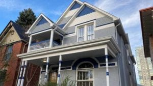 Photo of a gray and blue victorian exterior painted by kind home solutions