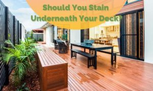 Article thumbnail with image of a nicely stained deck and title reading: Should you stain underneath your deck in greed bold letters